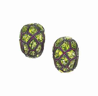 A pair of peridot and ruby earrings, by De Grisogono Each tapered bombé hoop set with fancy-cut peridot within a ruby-set surround of honeycomb design, post and clip fittings, 2.8cm long  Signed De Grisogono, no. B6515.