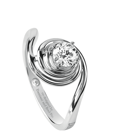A masterpiece of design from the historical archives of the Damiani workshops. Promise an extraordinary ring in white gold with a central diamond enhanced by the precious spiral supporting it. A refined piece of workmanship and craftsmanship to value a diamond solitaire. Designed by Damiani with Brad Pitt.