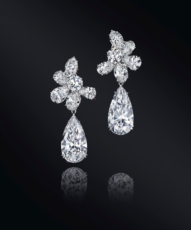A pair of D-color diamond ear pendants of 10.06 and 10.02, by Harry Winston. Estimate $1,500,00 - 2,000,000.