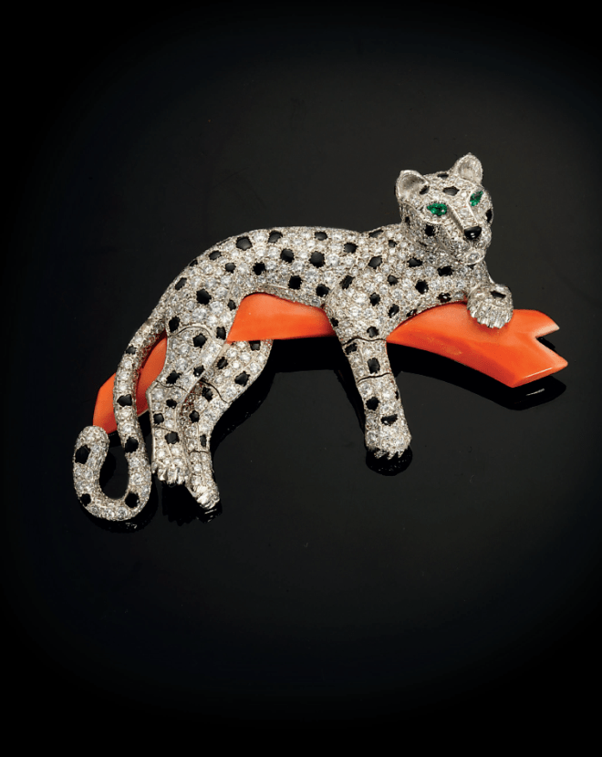 A coral, onyx and diamond 'Panthere' brooch, by Cartier Estimate: £60,000 - 100,000