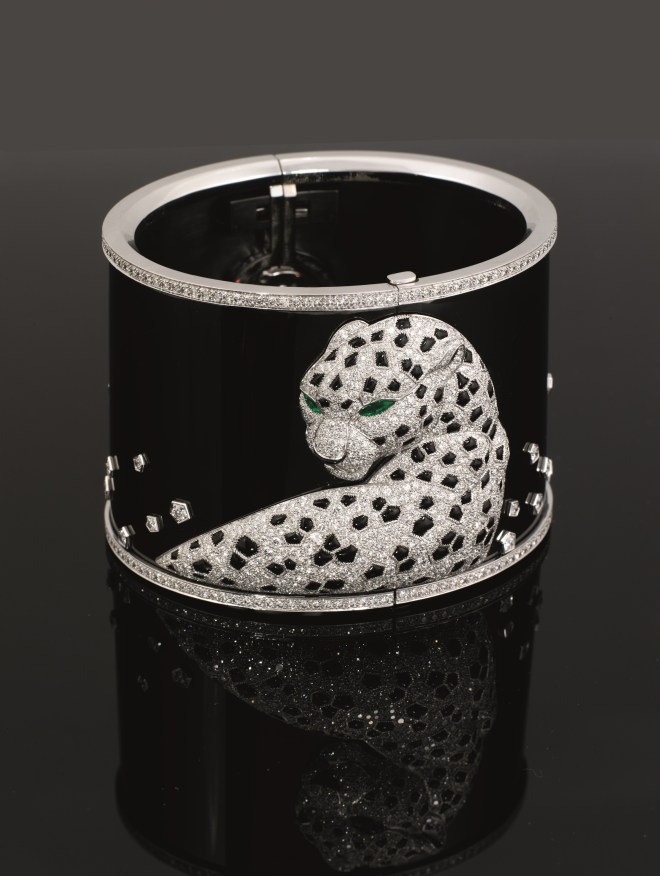 A unique 18 carat white and blackened gold diamond 'Panthere' watch, by Cartier Estimate: £180,000 - 250,000