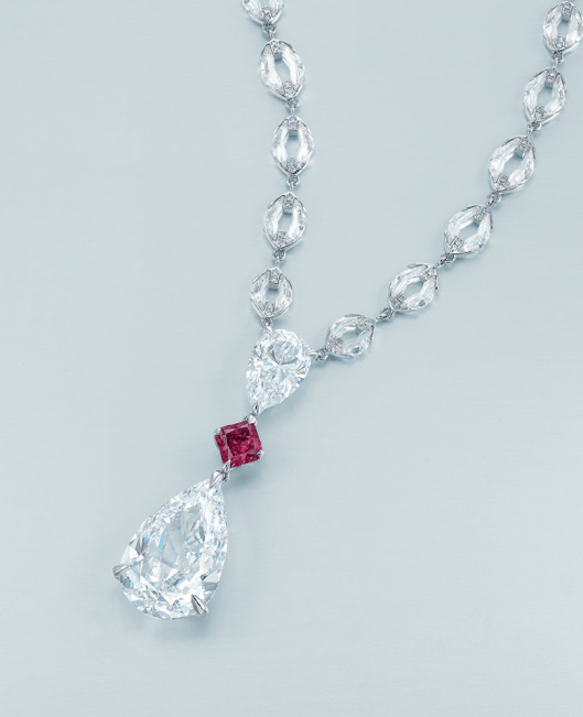 A UNIQUE DIAMOND AND COLOURED DIAMOND PENDANT NECKLACE, BY NIRAV MODI Set with a pear-shaped diamond weighing 10.02 carats, suspended from a pear-shaped diamond weighing 2.66 carats, spaced by a hexagonal-shaped fancy purplish red diamond weighing 1.03 carats, joined to the neckchain set with navette-shaped brilliant-cut diamond links assembled by combining two calibré-cut crescent-shaped diamonds, mounted in 18k white gold.