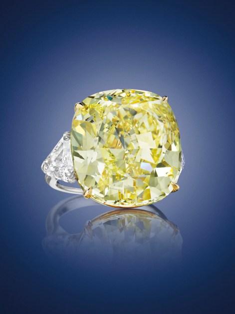 A CUSHION-CUT FANCY INTENSE YELLOW VS2 DIAMOND OF 28.02 CARATS ESTIMATE: $700,000 – $900,000