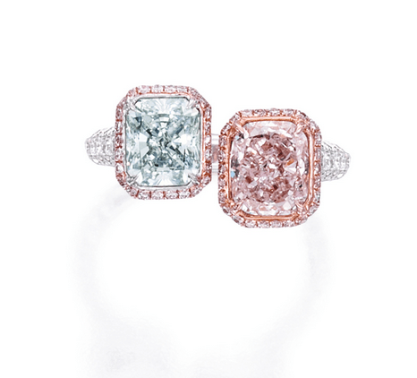 Set with a radiant-cut Fancy Light Gray Blue diamond weighing 1.32 carats and a cushion-cut Fancy Light Purplish Pink diamond weighing 1.63 carats, framed and accented by small round diamonds of pink hue and small round near colorless diamonds, together weighing .89 carat