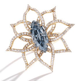 The marquise-shaped diamond of fancy vivid blue color weighing 3.18 carats, within an openwork mounting designed as a flower set throughout with small round near colorless diamonds, mounted in 18 karat pink gold.