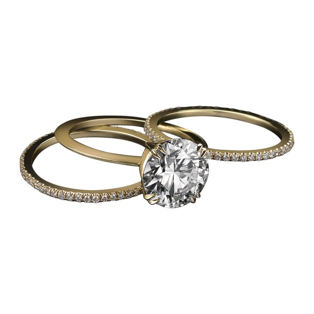 A set of three Diamond rings that may be worn together or separately. The center ring features a Round Brilliant-cut Diamond weighing 3.02 carats set on an 18- karat knife-edged band. The two adjacent gold bands are set with 1mm 'floating' Diamond melee. Signed by artist. Crafted in the USA. Limited Edition 1/50.