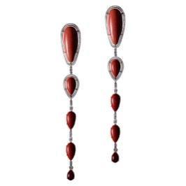 A one-of-a-kind dramatic pair of Coral and Diamond long drop earrings. Ten pear-shape Corals connected with fancy-shape Ideal-cut Diamonds. The corals, graduating from small to large, from pale pink to warm reddish pink to precious dark red; are encircled with Alexandra Mor's signature details of 1mm knife-edged wire and 'floating' Diamond melee. 17.5cm total earring length. 18-karat white gold. Signed by artist. Crafted in the USA. One-of-a-Kind 1/1.