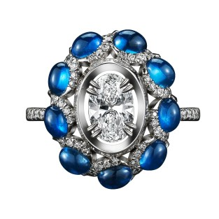 A one-of-a-kind Diamond ring comprised of 9 blue Oval-cut Sapphire Cabochons 2.45 total carat weight and a 0.51 carat Oval-cut Diamond 'floating' in the center, enhanced by Alexandra Mor signature details of 1mm knife edged-wire and 1mm 'floating' Diamond melee. Platinum set on an Alexandra Mor 18-karat yellow gold gallery. Signed by artist. Crafted in the USA. Made-to-order. One-of-a-Kind 1/1.