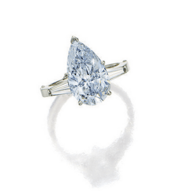 Simply set with a pear-shaped diamond of fancy blue colour weighing approximately 3.60 carats, flanked by baguette diamonds, mounted in 14 karat white gold.