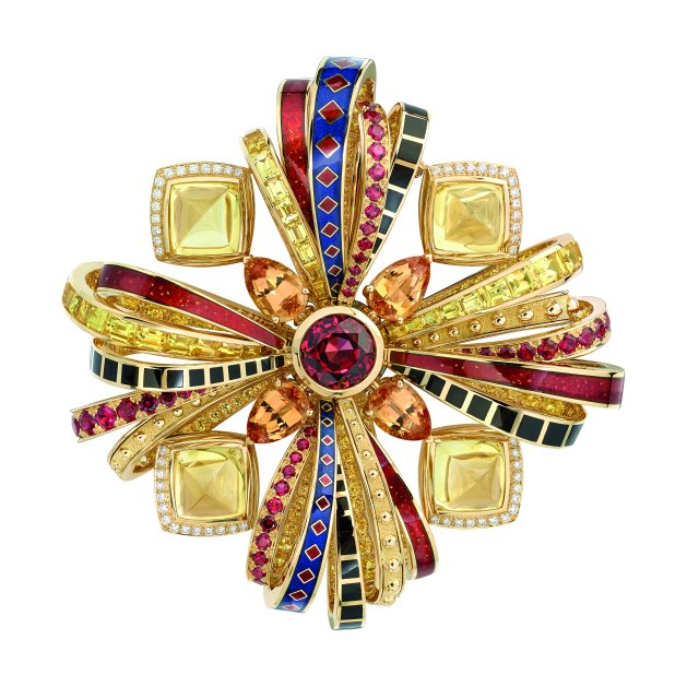 """Attirante"" brooch in 18K yellow gold set with a 5-carat brilliant-cut red spinel, 4 pear-cut orange topazes for a total weight of 8.1 carats, 4 sugarloaf-cut Sri Lankan yellow sapphires for a total weight of 27 carats, 29 calibrated-cut yellow sapphires for a total weight of 10.7 carats, 48 brilliant-cut red spinels for a total weight of 2.6 carats, 168 brilliant-cut yellow sapphirs for a total weight of 8 carats and 96 brilliant-cut diamonds for a total weight of 1.5 carat. CHANEL Joaillerie"