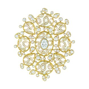 """Magnétique"" brooch in 18K yellow gold set with a 1.6-carat oval-cut diamond, 460 brilliant-cut diamonds for a total weight of 6.1 carats and 18 cabochon-cut crystals for a total weight of 47.9 carats. CHANEL Joaillerie"