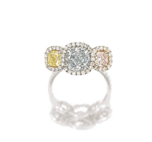 Set with a cushion-shaped light blue, fancy intense yellowand fancy light pink diamond weighing 1.33 carats, 0.50 and 0.40 carat respectively, framed by circular-cut diamonds, mounted in platinum and 18 karat pink gold.