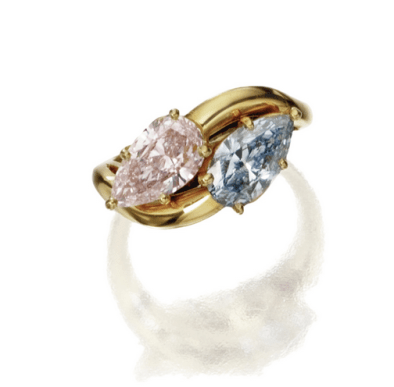 Set with a pear-shaped diamond offancy intense blue colorweighing 1.31 carats, and a pear-shaped diamond offancy light pink colorweighing 1.34 carats, mounted in 18 karat gold.