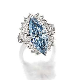 Centring on a marquise-shaped fancy grey-blue diamond weighing 4.37 carats, amid an elevated mount decorated with baguette, marquise-shaped and brilliant-cut diamonds together weighing approximately 2.80 carats, mounted in platinum.