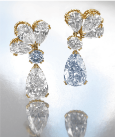 Each surmount designed as a cluster of three pear-shaped diamonds weighing 0.93, 1.07, 1.10, 1.10, 1.26 and 1.48 carats, suspending a brilliant-cutstone weighing 0.86 carat and a similarly cut fancy bluediamond weighing 0.85 carat, respectively suspending a fancy blue pear-shapeddiamond weighing 5.01 carats and a similarlyshaped stone weighing 5.61 carats, mounted in yellow gold.