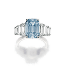 Set with an emerald-cut fancy intense blue diamond weighing 3.72 carats, flanked with inverted emerald-cut diamonds, accented by pavé-setbrilliant-cut diamonds, the diamondstogether weighing approximately 2.20 carats, mounted in 18 karat white gold.
