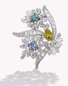 The fanciful floral bouquet set with a marquise-shaped Fancy Vivid Yellow, I1 clarity diamond weighing 2.86 carats, a round-cornered square modified brilliant-cut Fancy Intense Blue, VS2 clarity diamond weighing 2.47 carats and a round Fancy Intense Bluish Green, artificially irradiated, SI1 clarity diamond weighing 2.09 carats, accented by marquise-shaped diamonds weighing approximately 7.40 carats, further set with round, baguette and pear-shaped diamonds weighing approximately 9.20 carats, signed Bulgari, with maker's mark; circa 1960Estimate USD 500,000-700,000
