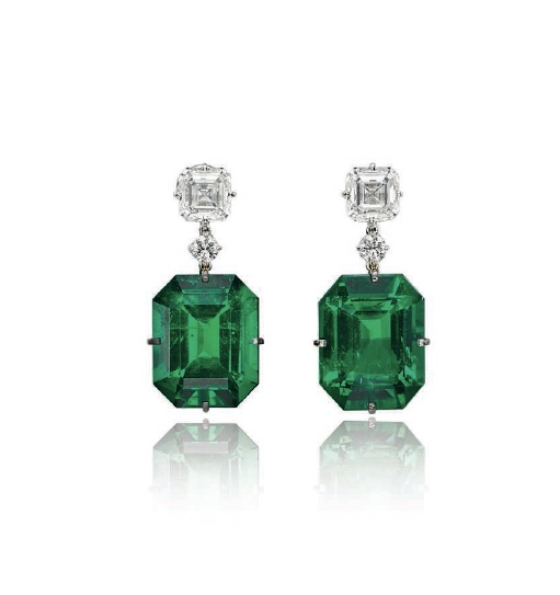 A pair of exceptional emerald and diamond earrings.