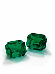 A pair of Colombian emerald and diamond ear pendants. Each octagonal step-cut emerald weighing approximately 13.56 and 12.91 carats are of Colombian origin with no signs of treatment. Estimate: US$2,449,501 - $2,959,814.