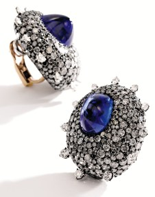 Pair of sapphire and diamond ear clips, JAR. Of bombé design, it features two sugarloaf cabochon sapphires within a mount pavé-set with diamonds. Estimate $500,000-800,000.