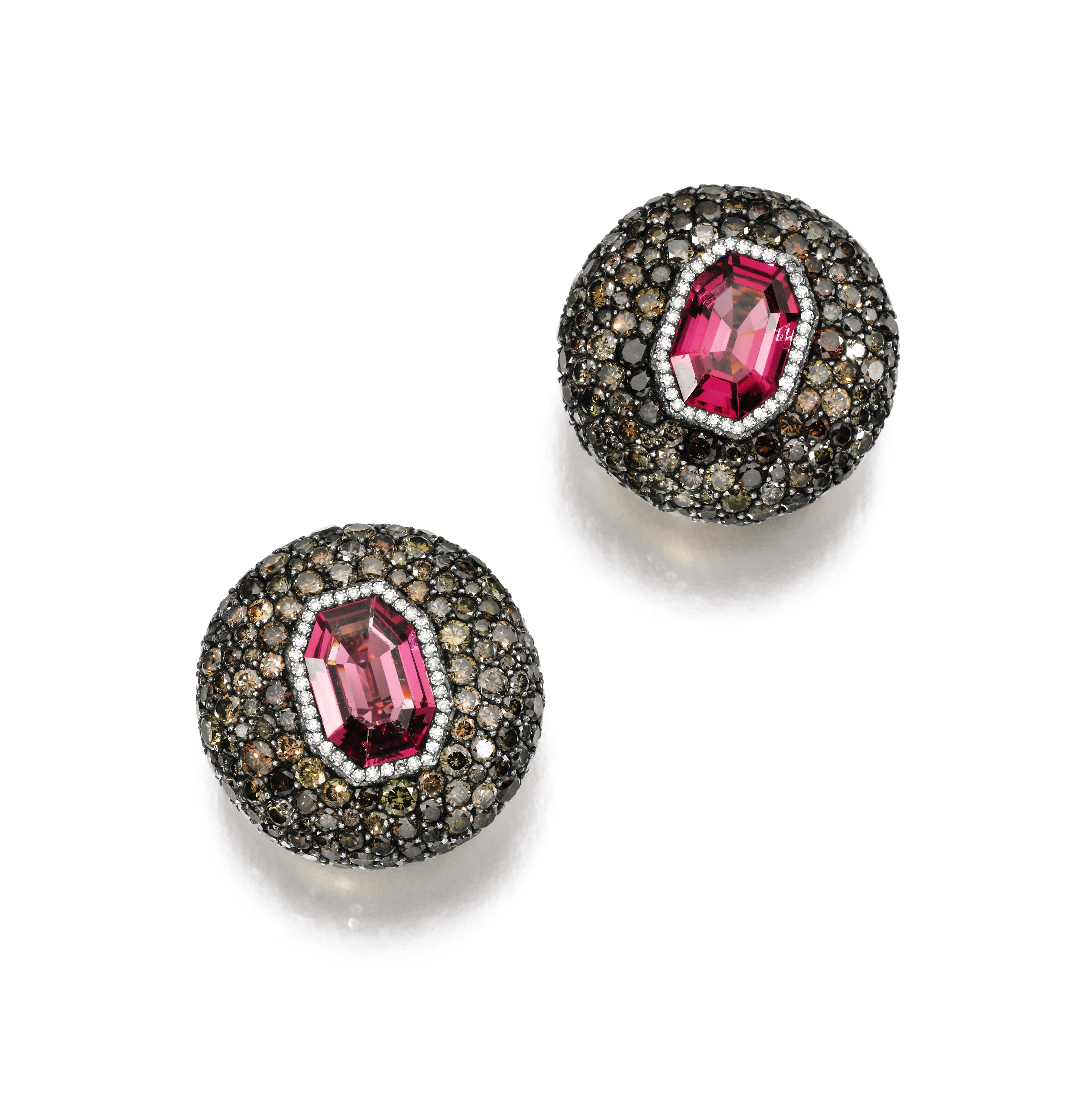 Pair of spinel and diamond earclips, JAR. Adorned with brilliant-cut diamonds of brown tint each clip featuring at its centre a stunning octagonal spinel. Estimate $150,000-250,000.