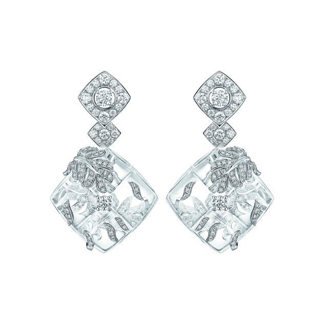 """Signature Cocoon"" earrings in 18K white gold set with 251 brilliant-cut diamonds for a total weight of 3 carats and carved rock crystal."