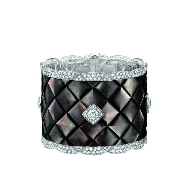 """""""Signature de Nacre"""" cuff in 18K white gold set with 496 brilliant-cut diamonds for a total weight of 20.3 carats and carved mother-of-pearl."""