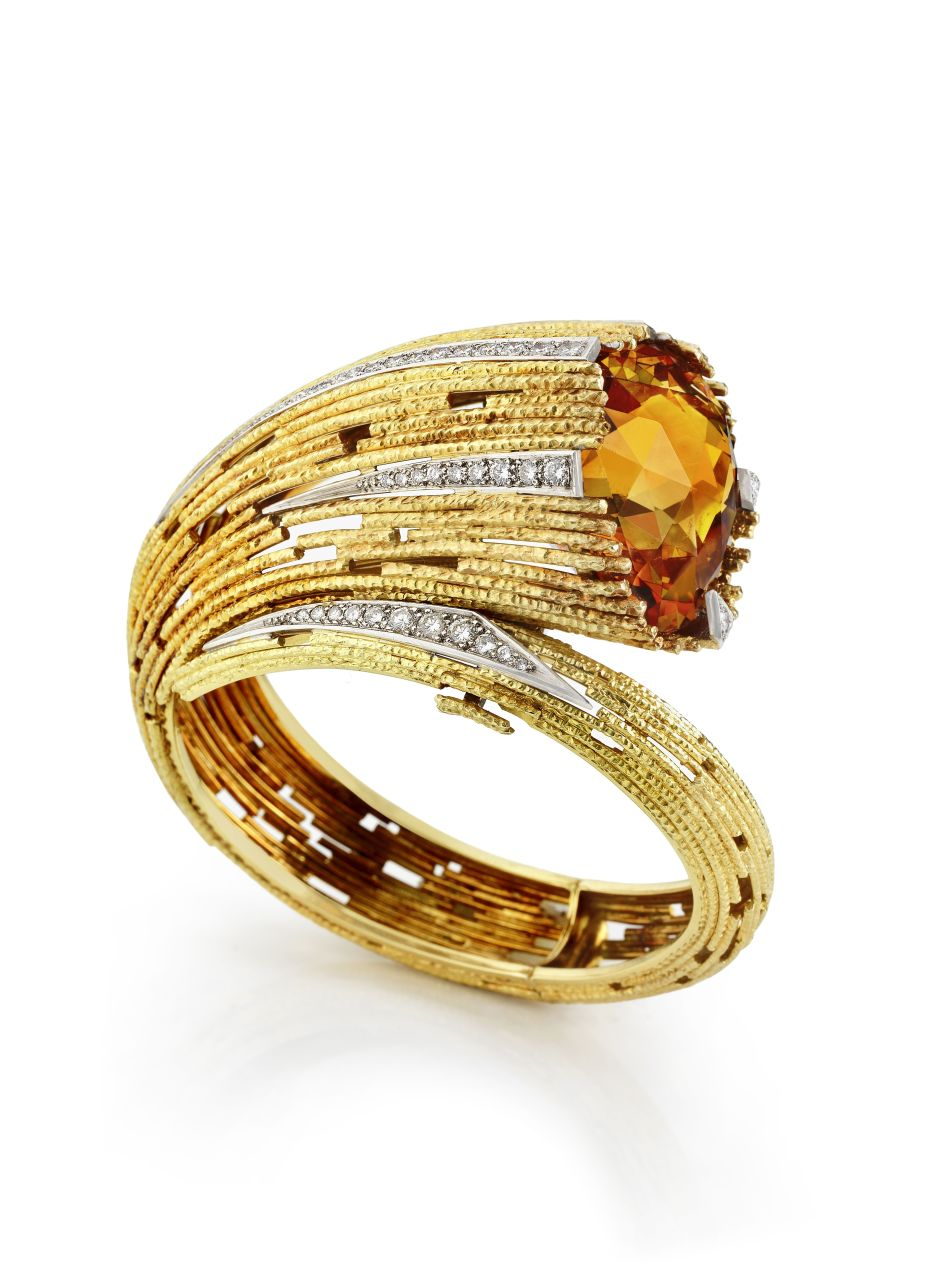 A citrine and diamond-set bangle by Andrew Grima