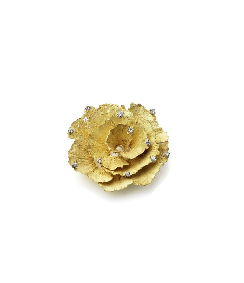 A gold and diamond 'pencil shavings_ brooch by Andrew Grima