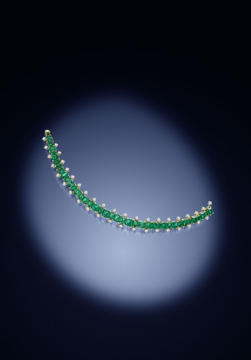 An emerald and diamond bracelet by Cartier