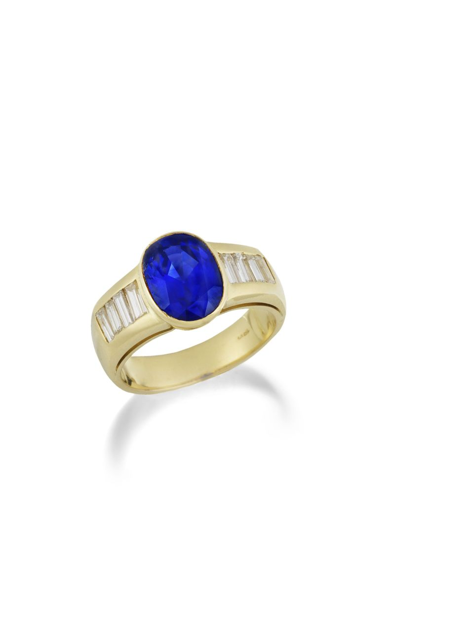 A Gold, Sapphire and Diamond Ring. Lot 95