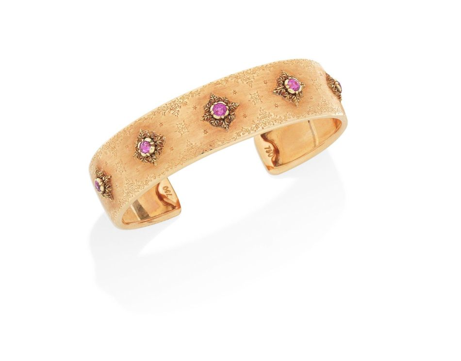 A varicoloured gold and multi gem-set bangle, by Mario Buccellati,