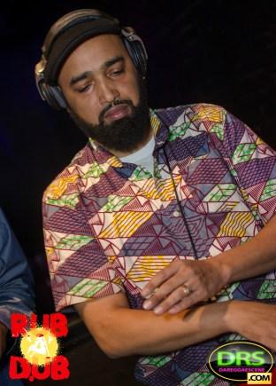 Photo of DJ Passport mixing reggae songs.