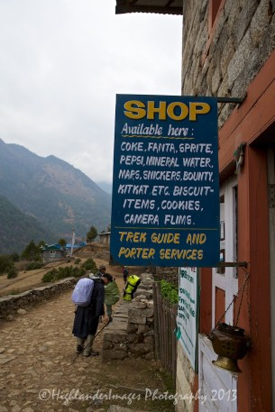 "Local shop on the trail from Lukal to Phakding selling a number of snack foods and importantly some ""camera films""!"
