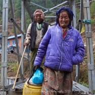 Two Nepalese ladies cross the bridge at Koshigaun village between Lukla and Phakding