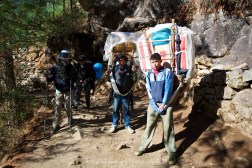 Porters resting their loads as they head up the trail between Jorsalle and Namche Nazaar