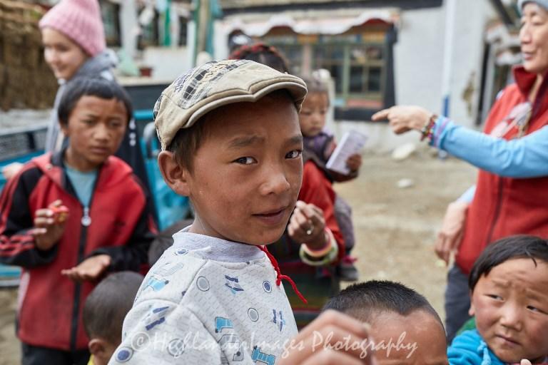 Donating to poor children in Zhabu village in Qomolangma National Nature Reserve, Tibet