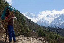 A porter takes a rest on the final trek into Lukla from Monjo.