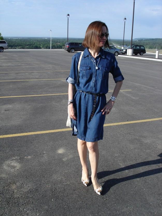 stylist in denim dress with western belt