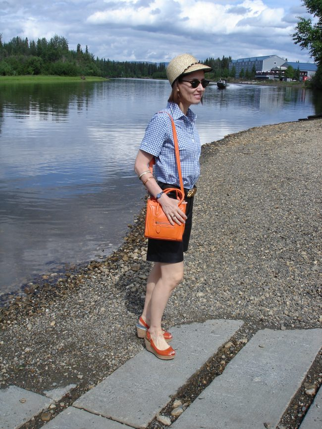 over 50 years old woman in leather shorts and straw hat