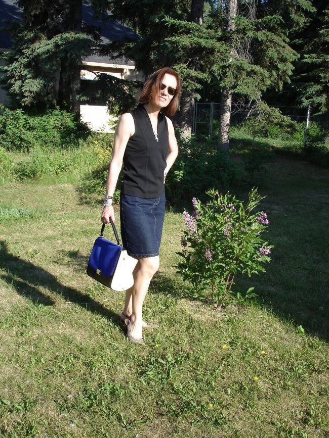 influencer in denim skirt, silk shirt, sandals