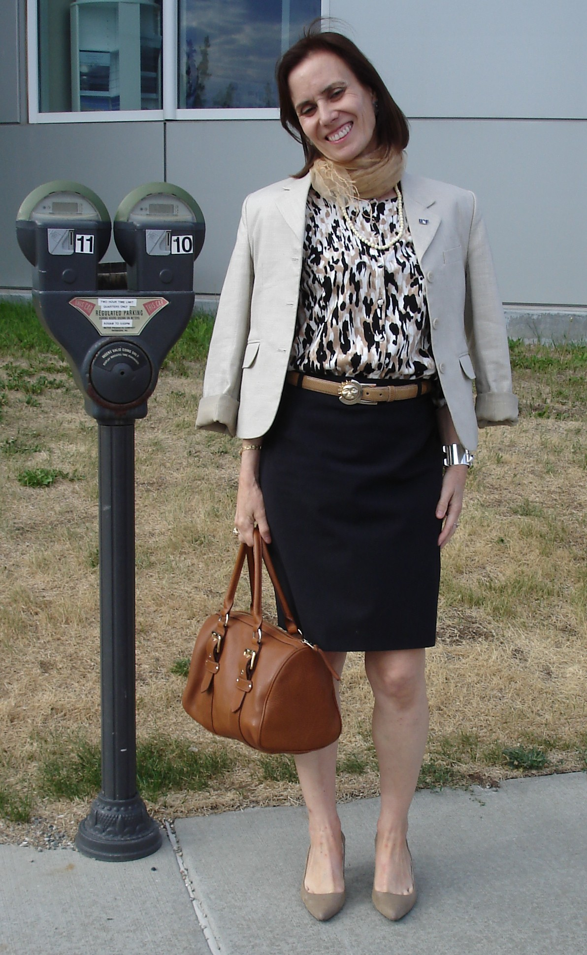 mature woman wearing a skirt and top in job interview style