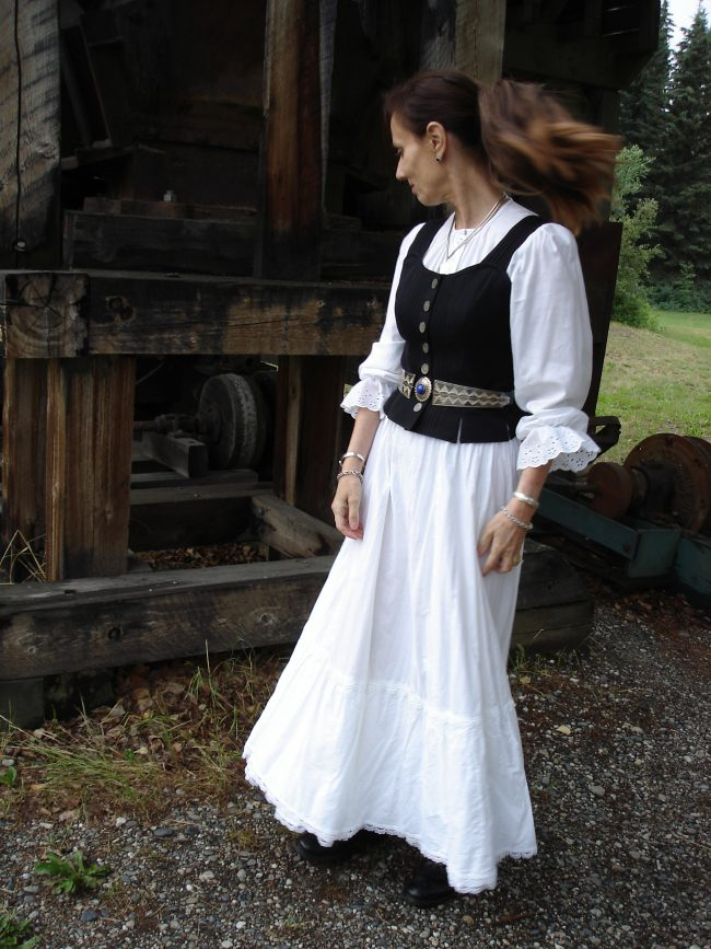 blogger in 1890s inspired pioneer time women costume in white with vest