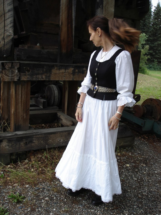 1890s inspired pioneer time women costume in white with vest