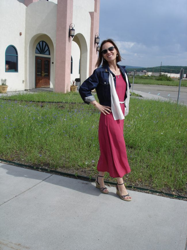 petite blogger in small print slip dress with cropped denim jacket and wedges in red-white and blue