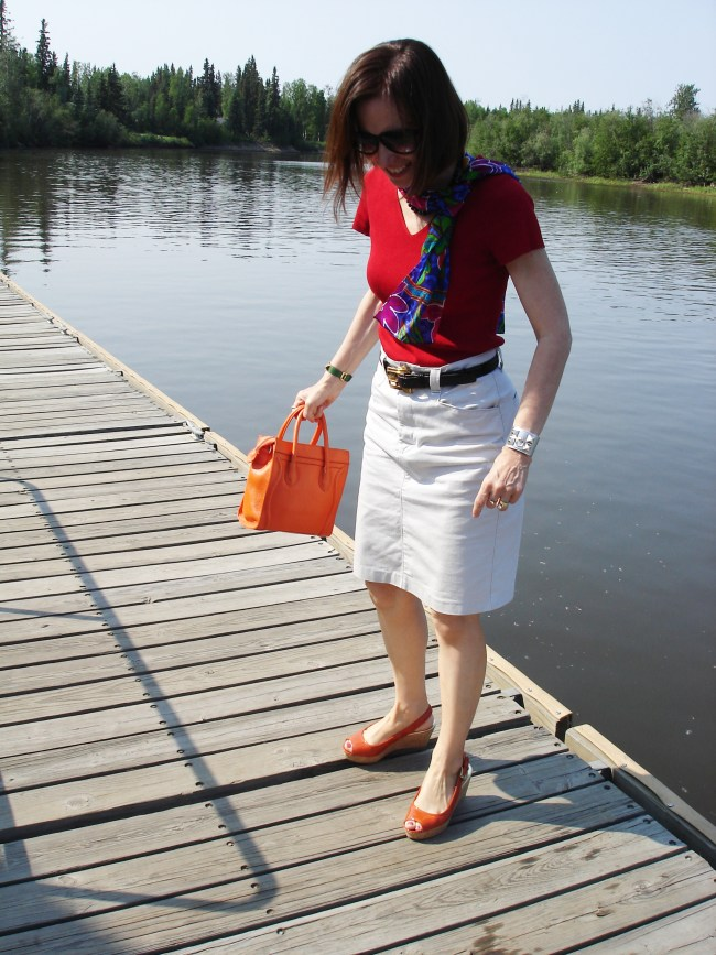 over 40 year old in posh casual summer look with red and orange