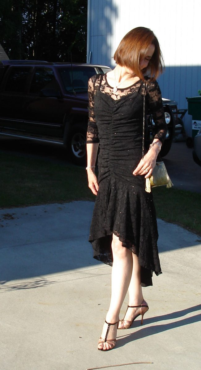woman in lace cocktail dress