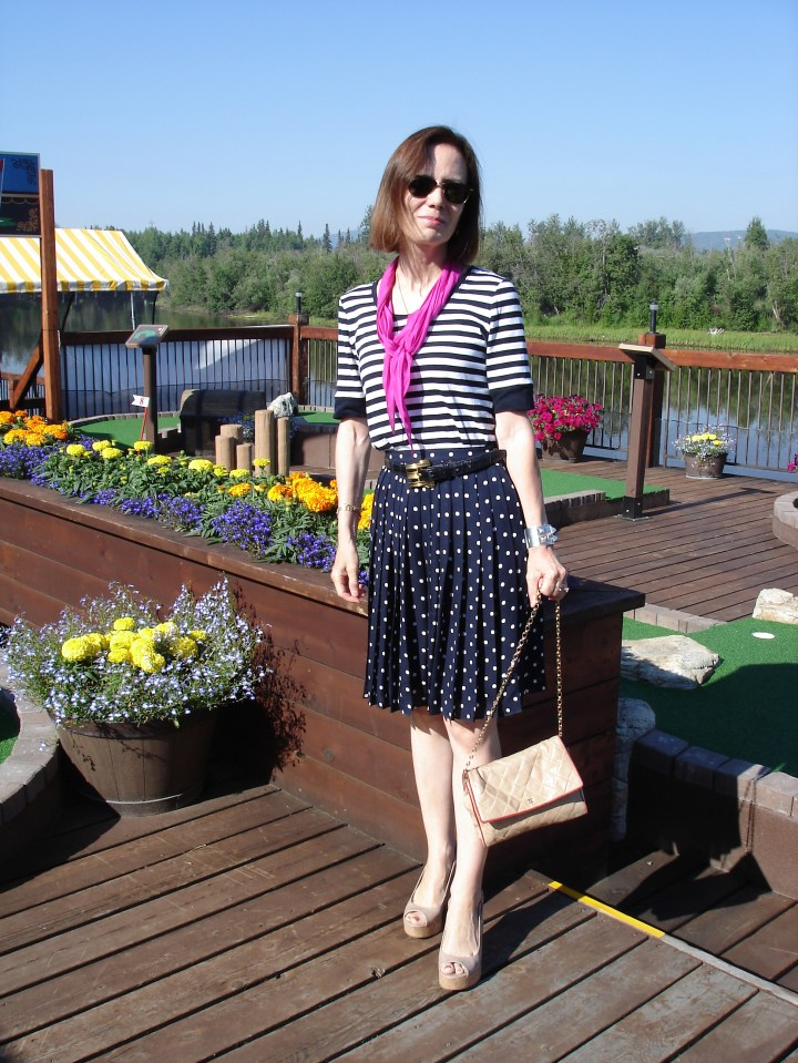#styleover50 woman wearing stripes and polka dots in one outfit