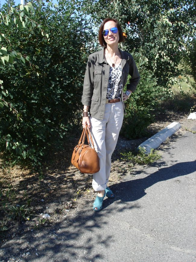 style blogger in chinos, utility jacket printed top turquoise fall sandals, tan satches