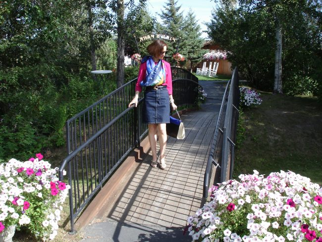 influencer in Chambray button-down shirt, denim skirt, sandals